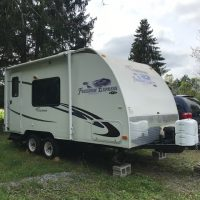 2010 20-ft Coachman Freedom Express camper.  Bed, dinette that converts, shower, kitchen, antenna.